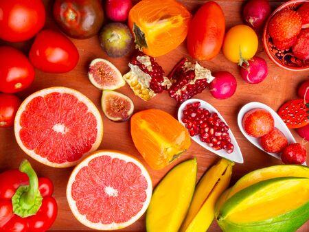 fresh red, orange, yellow fruit and vegetables rich in antioxidants, fiber, alfa carotene, lycopene, beta carotene, carotenoid, lutein, phosphorus, calcium, vitamin c, a good for health Stock Photo