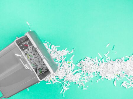 Overcrowded heap of shredded paper in trash, Concept of recycle and office work of confidential
