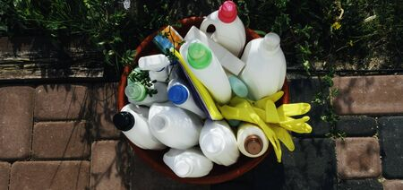 Cleaning variety supplies, group of colorful plastic bottles outdoor, House cleaning product Zdjęcie Seryjne