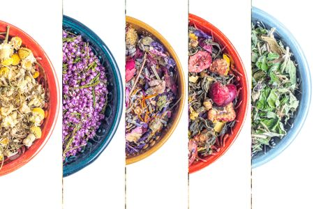 Healthy Heather dried flowers tea and different herbs in ceramic bowls. Homeopathy and herbal medicine, disinfectant, anti inflammatory, close up, selective focus