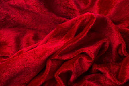 Soft Luxurious red velvet fabric background, close up