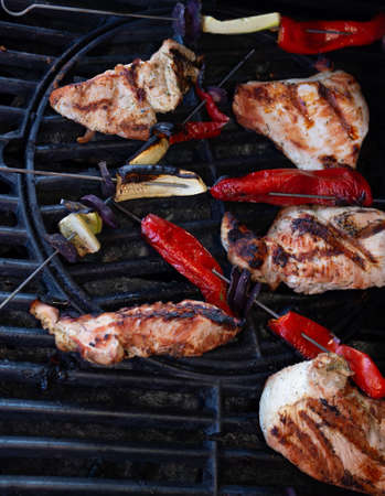 Grilled chicken breast with vegetables, bell pepper, beet, eggplant slices, grill skewers with vegetables and meat, picnic concept. Selective focus