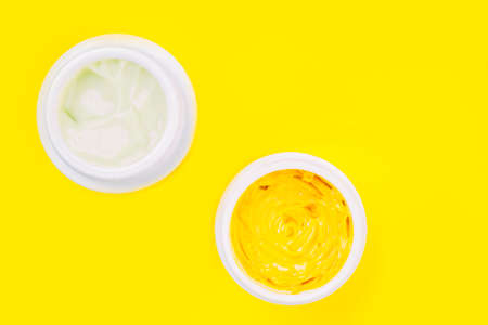 white jar with cream on a trendy yellow background with copy space. Skin care concept Stock fotó