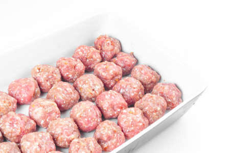 homemade raw organic mincet meat balls, uncooked, isolated on white, close up. Chinese food
