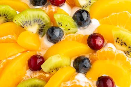 Tasty fresh whipped cream fruit cake, beautiful decorated, tart with kiwi, apricot, orange, grape, cranberry. Stock fotó