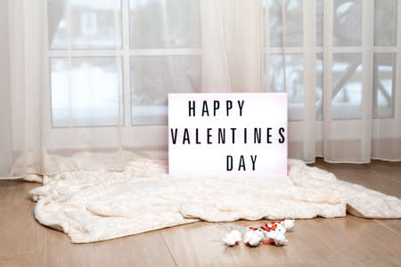 Board With English Text Happy Valentines Day on soft carpet indoor