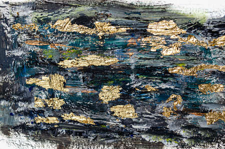 Marbled black and gold abstract background. Liquid marble pattern. Design wrapping paper, wallpaper. Mixing acrylic paints.
