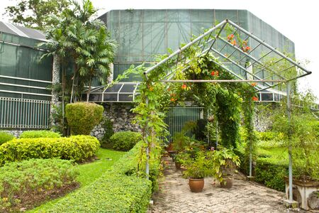 Old glass house in the garden, Thailand photo