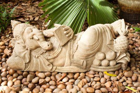 indian god: Ganesha, Indian God lie down and reading