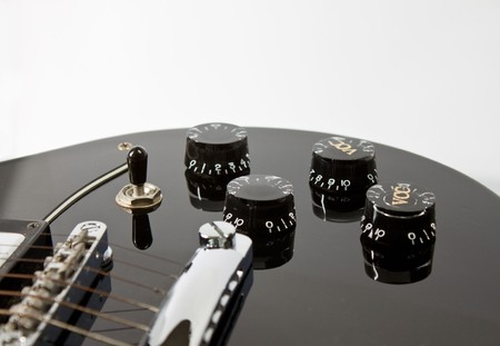 Black guitar with volume adjustment Stock Photo - 8108257