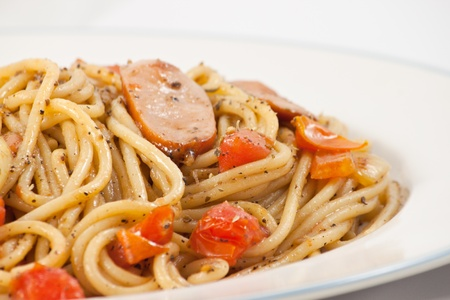 Black pepper spaghetti with sausage in plate