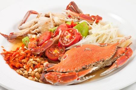 Thai style big boiled crab papaya salad photo