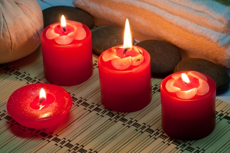 Red candle in spa room photo