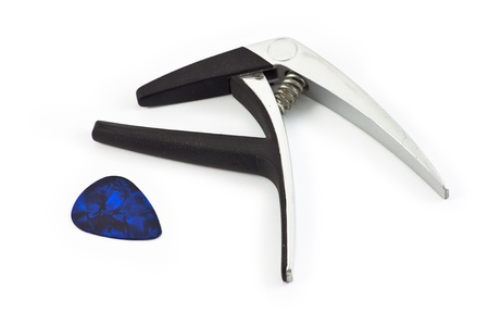 Guitar capo with guitar pick on white background photo