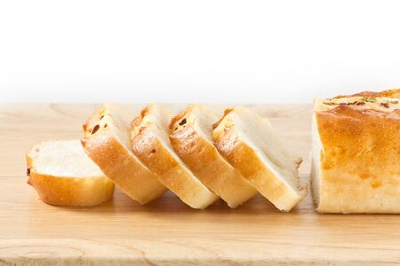 Stack of Garlic bread on wood cut board photo