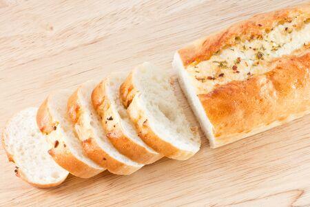 Stack of Garlic bread on wood cut board photo
