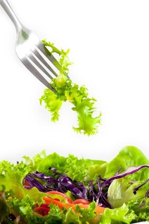 Lettuce from vegetable salad on fork
