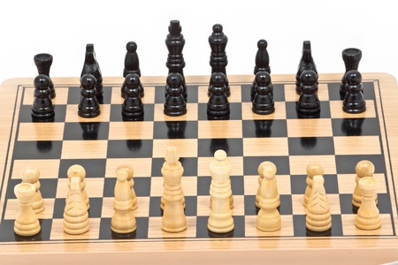 Chess battle on wood board Stock Photo