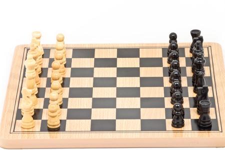 Chess battle on wood board photo