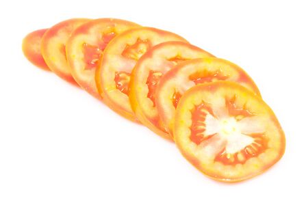 Fresh tomato chopped in line on white isolated photo