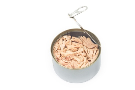 Tuna in vegetable oil in opened can on white isolated Stock Photo
