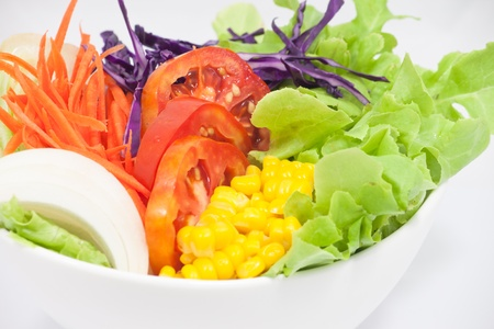 Vegetables Salad in white bowl photo