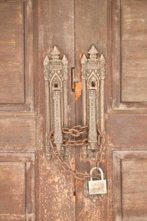 Wood old door with chain locked photo