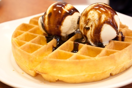 Waffle  and icecream with chocolate topping in plate photo