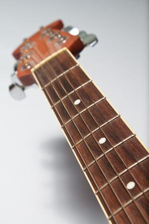 Guitar neck on white background