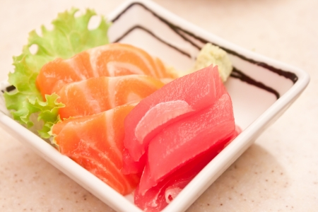Raw fish sashimi in plate photo
