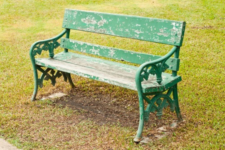Old green bench in peaceful park photo