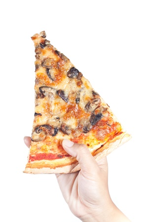 Slice of pizza mushroom in hand on white background photo