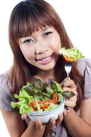 Young woman giving you vegetables salad on fork, healthy eating  concept Stock Photo - 14177754
