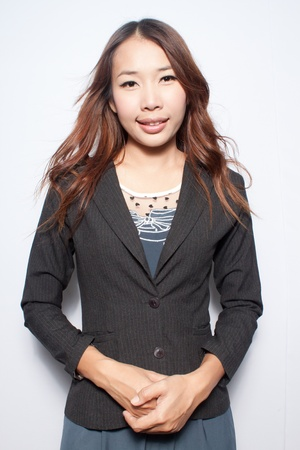 Asian young business woman smiling with confident photo