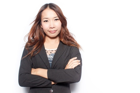 asian young business woman with arms crossed and smiling photo