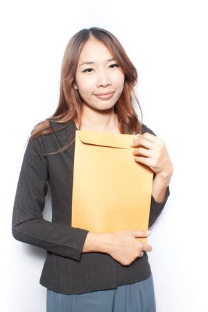 Young business woman holding  envelop photo