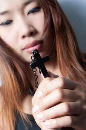 A rosary in woman hand photo