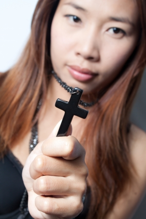 Black Rosary in woman hand photo