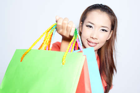 Asian  woman with colorful shopping bags Stock Photo - 14451509