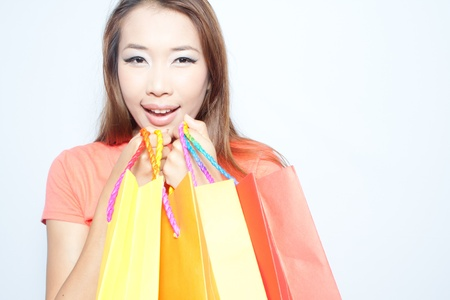 Asian woman smiling and holding colorful shopping bags Stock Photo - 14451506