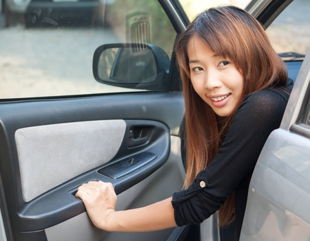 Happy woman in the car with opened door photo