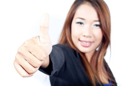 Young business woman thumb up on white background photo