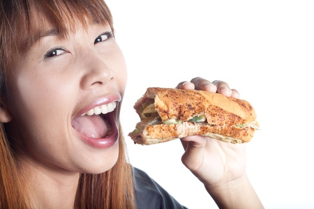 Young  happy girl going to eat ham sandwich on white background