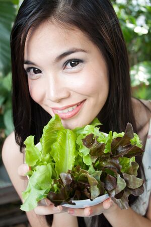 Young Healthy woman with organic vegetables salad Stock Photo - 15003144