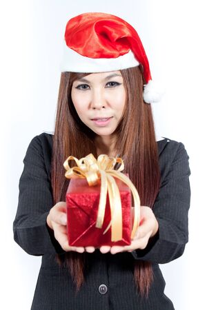 Business woman wearing a santa hat and holding a christmas gift photo