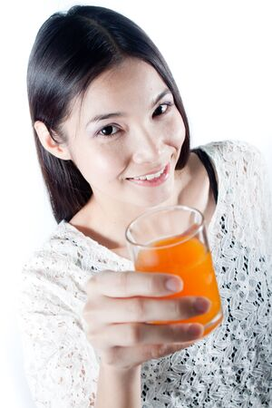 Healthy woman smiling and holding a glass of orange juice Stock Photo - 15003110