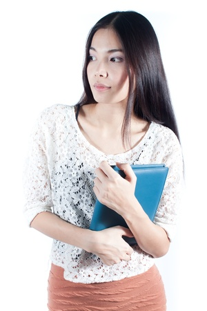 Young asian student with her blue notebook on white background, education concept photo