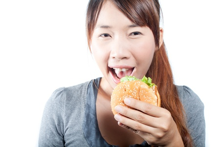 Young  woman going  to eat fish burger photo
