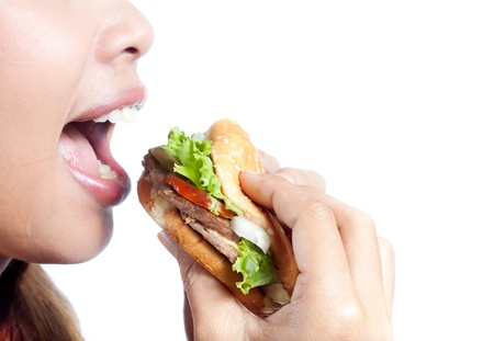 adult sandwich: Young woman going to eat burger on white background