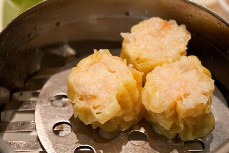 Delicious hot Dim-sum food in it photo
